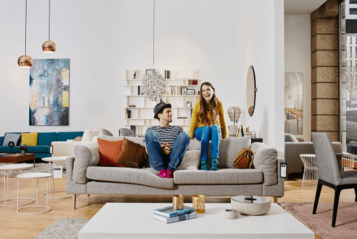 Couple in modern furniture store smaller